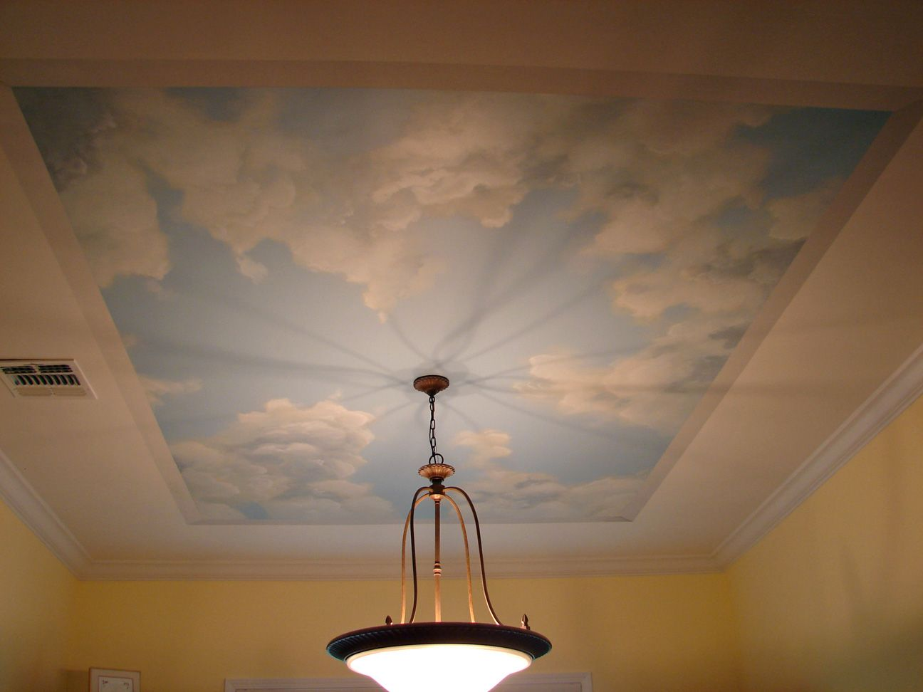 full view of a hand painted dining room ceiling sky cloud mural