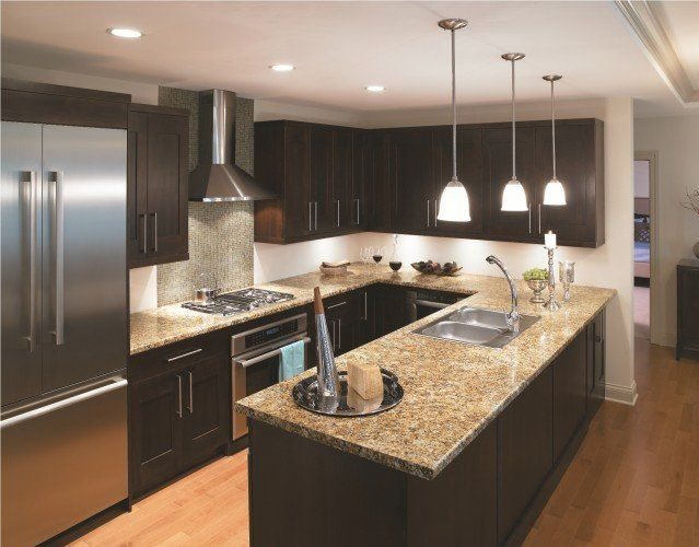 dark wood kitchen cabinets with stainless steel appliances images