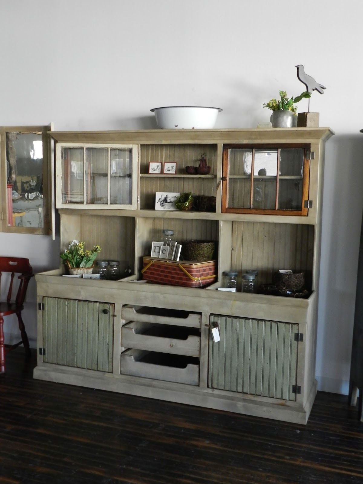 In vogue distressed cabinet with clear glass door top and opened