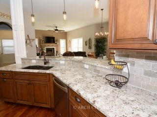 White Granite Color Paired With Medium Maple Cabinets And Travertine Back Splash Granite Countertops Kitchen Maple Kitchen Cabinets Upper Kitchen Cabinets