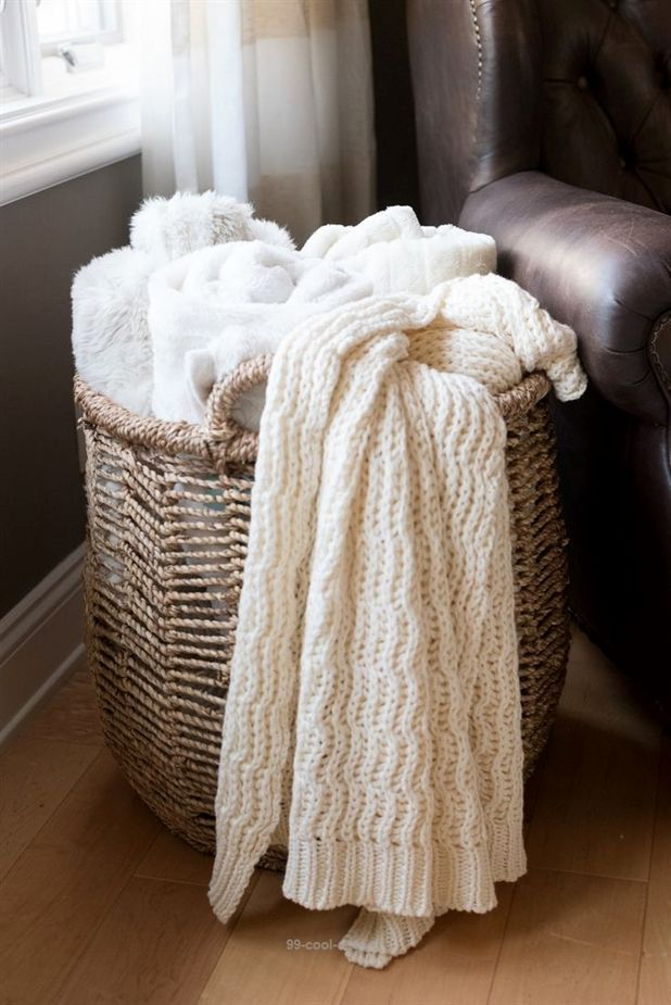 HomeGoods basket filled with cozy throw blankets. # ...