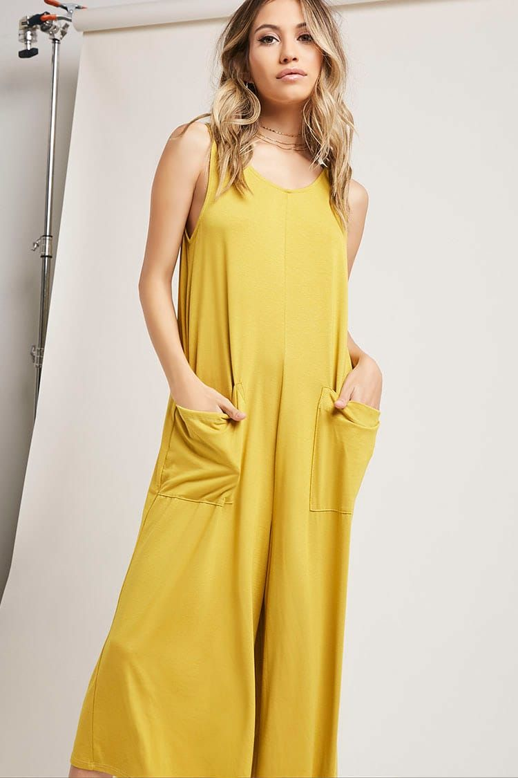A soft knit jumpsuit featuring a scoop neck, sleeveless cut, patch front pockets, and a culotte leg.<p>- This is an independent brand and not a Forever 21 branded item.</p>