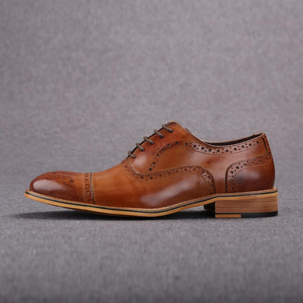 Men Brown Oxford Brogue Genuine Leather Formal Shoes is part of Leather formal shoes - Brown Oxford shoes are lifesavers of a sort because they can be worn with almost anything! Since these are highquality ones, you can rest assured they will go equally well with jeans and tweed  This pair will be a great addition to any unique shoe collection  These oxfords can be worn with 2 and 3piece business suits and casual suits, whatever suits your taste! Suits with bold patterns and material blends will also be perfect with these shoes  No matter which color suit you are wearing, these shoes go along with every shade  Be it grey, dark brown, or navy colored suits  In fact, many style experts prefer them over wearing black due to their far more visually striking effect  The shoes are constructed from 100% Genuine Leather for maximum durability The only premium quality leather is used in the making of these shoes Each pair is handmade, which means your pair would be one of a kind Laces are sold along with the shoes Use the size chart given below to ensure you buy the right size  In case, the shoes you ordered don't fit, you may return them and get the right size without additional cost These brown oxford shoes will make choosing a suit easier  If you feel like a change, then simply switch your shoelaces with ones in another color for a fresh new look! Don't feel like it, go back to the brown ones  Simple!