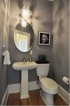 Chic Powder Room With A Pedestal Sink And Beautiful Pendant
