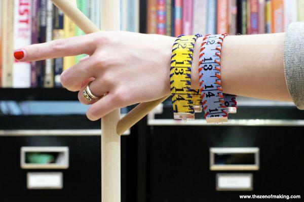 http://www.thezenofmaking.com/2013/01/tutorial-measuring-tape-bracelet.html