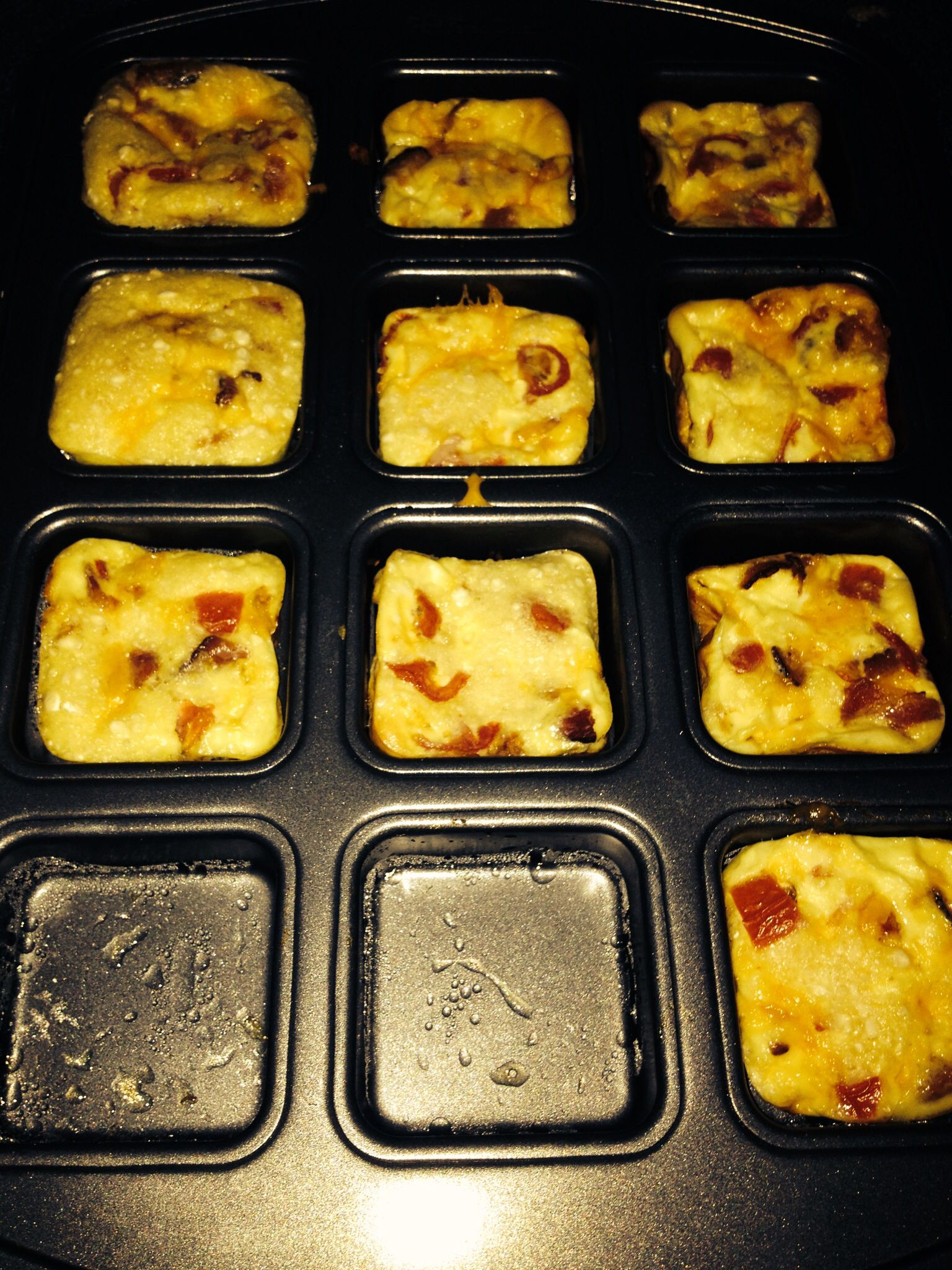 My breakfast quiches for breakfast and made them In the brownie pan! Perfect portion size!