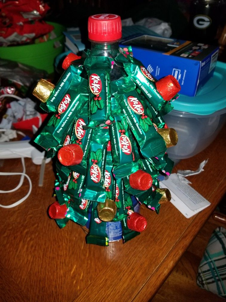 Christmas tree made with a can of nuts for the base, a soda bottle ...