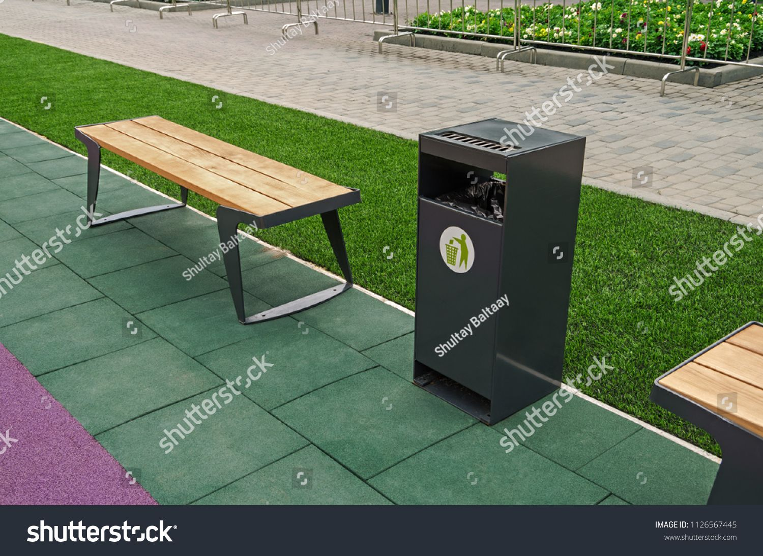 Marvelous A Wooden Bench For Rest And A Garbage Bin For Waste In A Machost Co Dining Chair Design Ideas Machostcouk