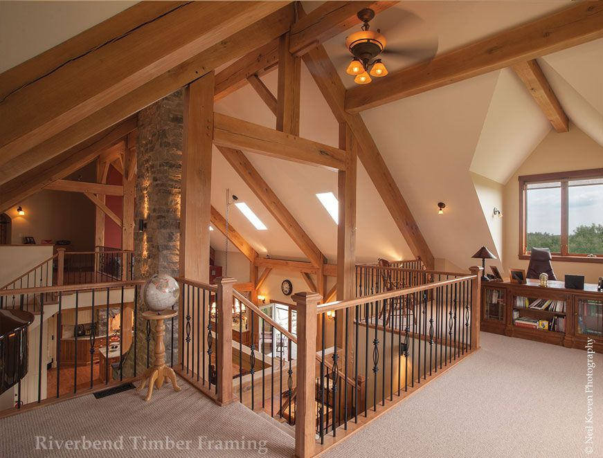 Large timber trusses create an open space in traditional barn timber ...