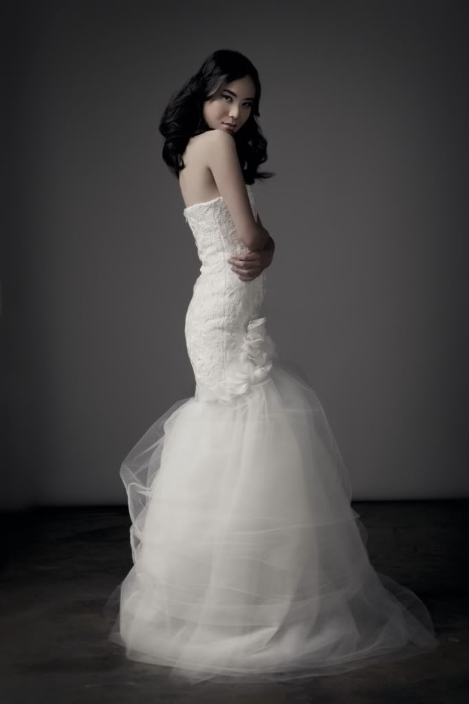 Chloe Dao Bridal Mermaid Gown With A Lace Overlay Bodice Silk Ruffles At The Thighs And Ending In Wispy Cloud Of Tulle