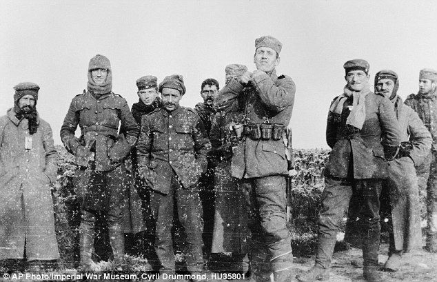 christmas truce german and british soldiers stand together on the battlefield near ploegsteert belgium