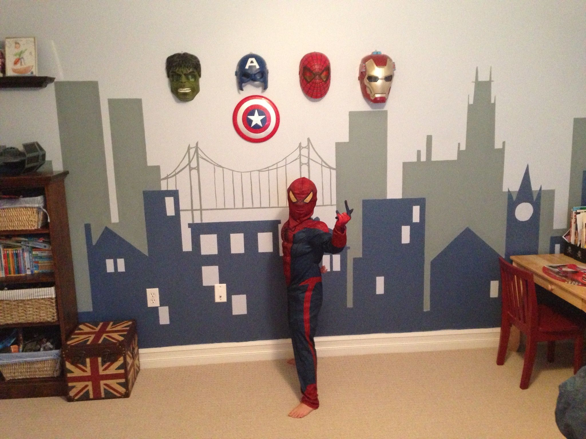 I like the idea of hanging the masks on the wall for Boys room wall mural