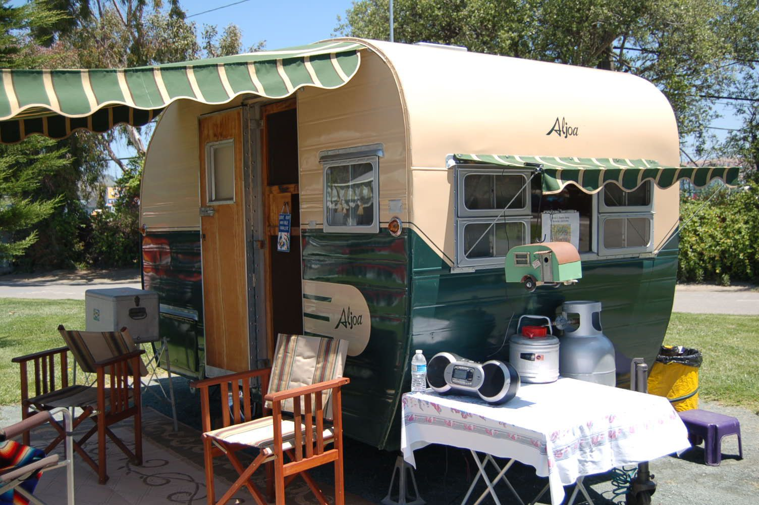 Restored Vintage 1955 Aljoa Travel Trailer Painted Green And White With Striped Awnings
