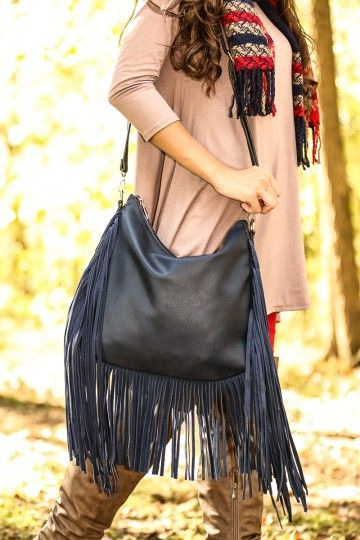 Navy, fringe bag! An amazing accessory to pull your outfit together!