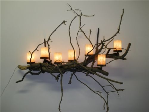 wall art made from twigs | Branch Lighting is this lovely Twig Wall Sconce . The pillars are made ... #twigart