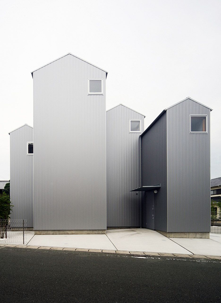 These four house-shaped volumes may look like individual homes but ...