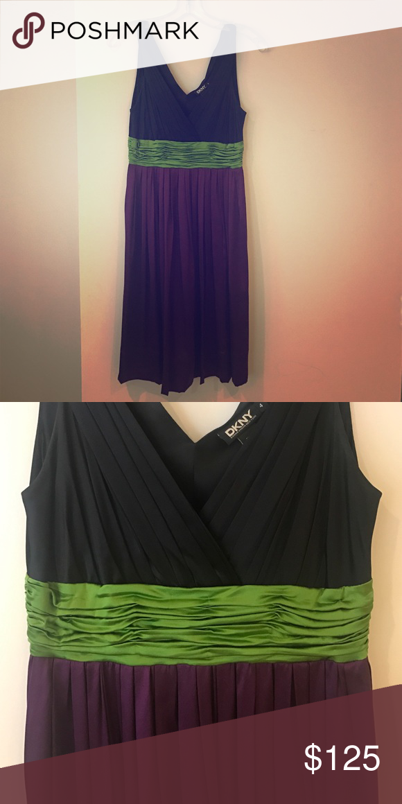 Cocktail DKNY dress! Worn only 1x! Satin and gorgeous. Wear to a party or a night on the town! Navy, purple and green. DKNY Dresses Midi