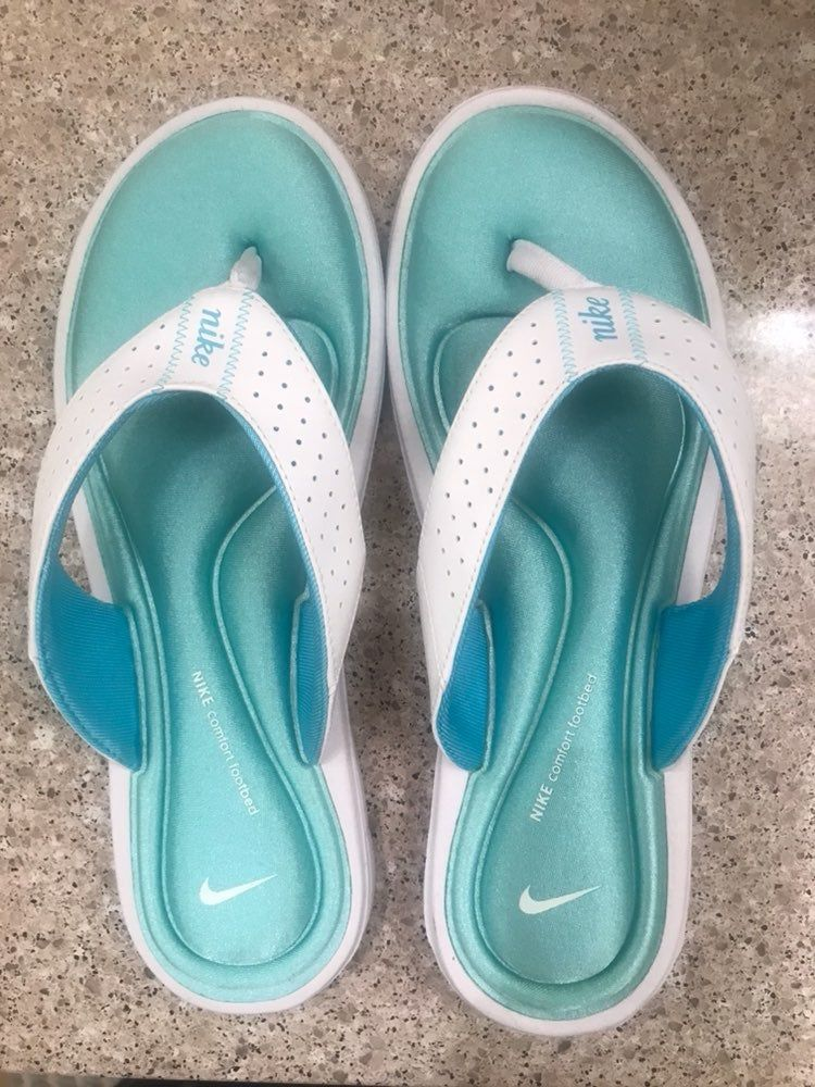 Nike Flip Flops teal and white. Brand