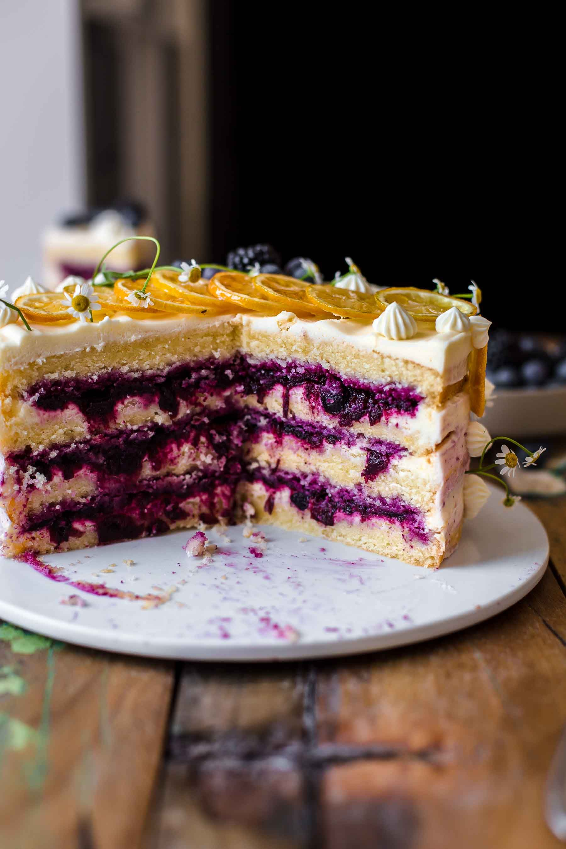 This moist and fluffy Lemon Blueberry Cake is tangy sweet and delicious Lemon Blueberry Cake Recipe by Also The Crumbs Please