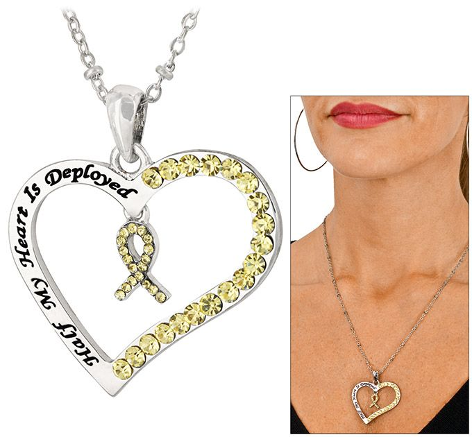 """Half My Heart is Deployed Yellow Ribbon Necklace  Provides 1 Meal(s) for Veterans.  $15.95  When your loved one is deployed overseas, half of your heart goes right along with them. Our necklace expresses your whole heart, with a sparkling yellow ribbon to match the spark you carry for your brave military hero.  Silver-tone metal & crystal.  Reads """"Half my heart is deployed""""  Pendant: 1.25"""" H x 1.5"""" W (3.2 x 3.8 cm). Silver-tone chain: 18"""" L (45.7 cm) with 3"""" L extender (7.6 cm)."""