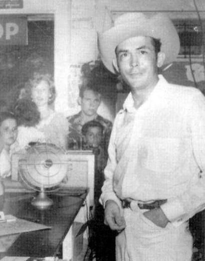 Hank Williams greets fans at a Texas record store in December 1952, just a few weeks before his death.