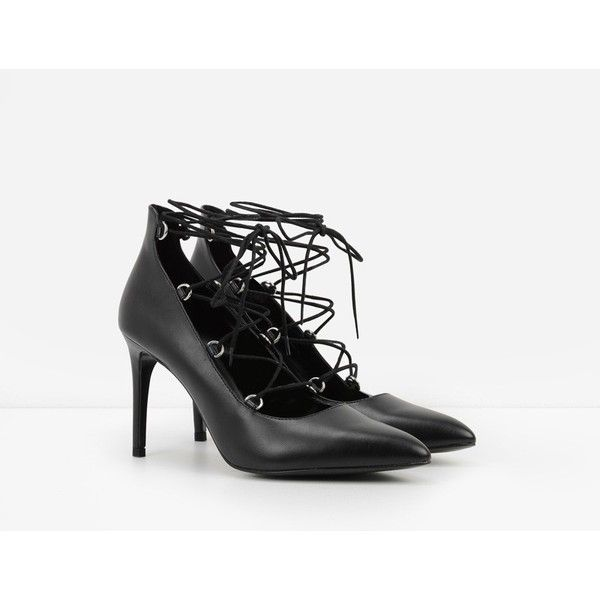 CHARLES & KEITH Ghillie Stilettos ($49) ❤ liked on Polyvore featuring shoes, pumps, black, lace up pumps, black t strap shoes, t strap pumps, black lace up pumps and high heels stilettos