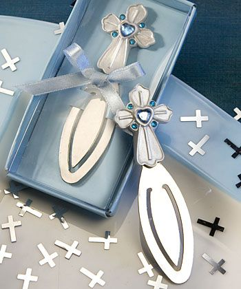 "The perfect way to mark your special day these cross design bookmark favors are sure to remind your guests of the beautiful faith you share. Great as Baptism or First Communion favors, for a boy, each bookmark measures 3 .5"" x 1"" and has a detailed white pearlized poly resin cross charm with a central heart-shaped blue rhinestone bordered with round blue rhinestones, attached to a sturdy silver metal page clip. Each favor comes packaged in a blue bottomed gift box with a clear top and blue…"