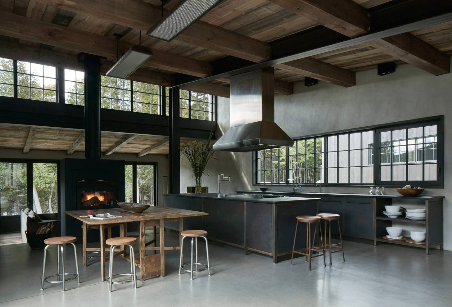 Rustic industrial kitchen/dining space in a large open
