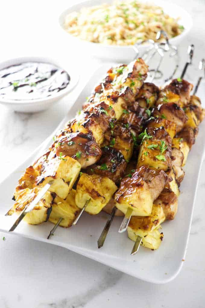 Grilled Pineapple Chicken Kabobs #chickenkabobmarinade Tender, juicy chicken and sweet pineapple make an amazing combination. The marinade gets turned into a thick glaze for these pineapple chicken kabobs. #chickenkabobmarinade Grilled Pineapple Chicken Kabobs #chickenkabobmarinade Tender, juicy chicken and sweet pineapple make an amazing combination. The marinade gets turned into a thick glaze for these pineapple chicken kabobs. #chickenkabobmarinade Grilled Pineapple Chicken Kabobs #chickenkab #chickenkabobmarinade