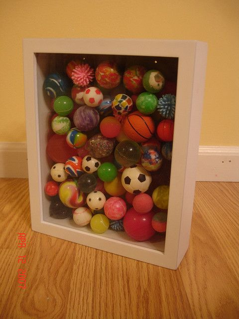 Bouncy ball collection displayed in a deep shadow box (part of a larger collection) by Sharna11 via Flickr.