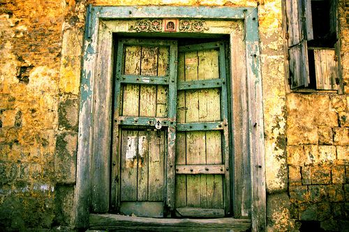 worn, beautiful decay of an old door and wall, patina