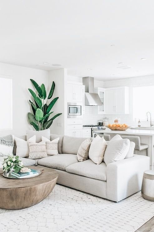 This Is A Well Staged Living Room You Can See Both The Living Room And The Kitche In 2020 White Living Room Decor Modern White Living Room Small Apartment Living Room