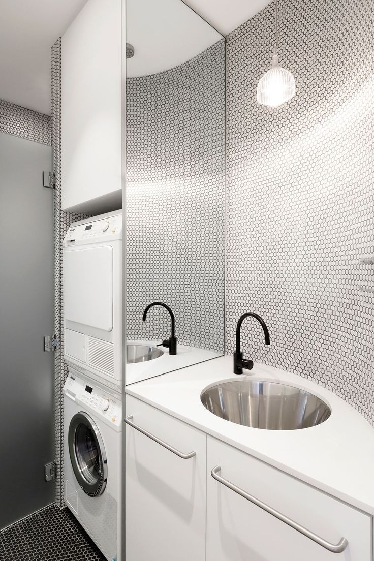 Compact small-space laundry: curved wall, white hexagonal mosaic ...