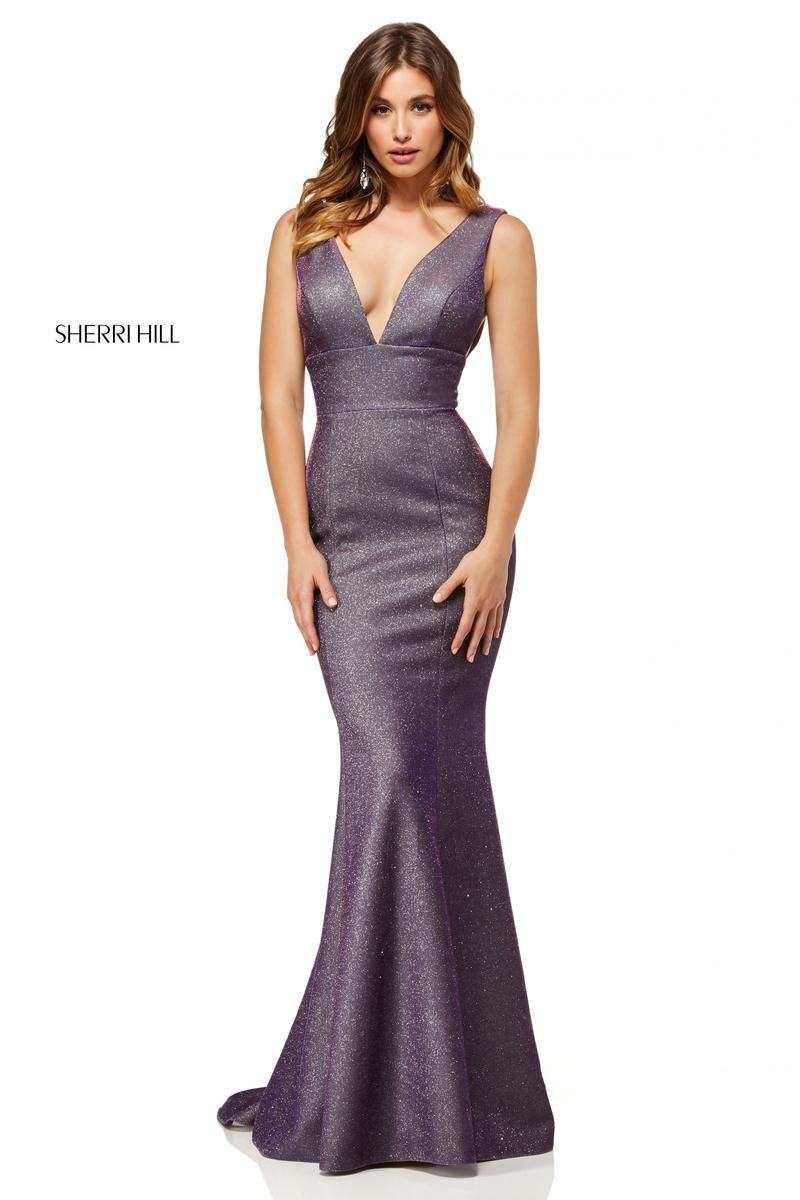 e08f2a6de5e Style 52480 from Sherri Hill is a shimmering plunging V neck sleeveless  fitted prom gown with an open V back.