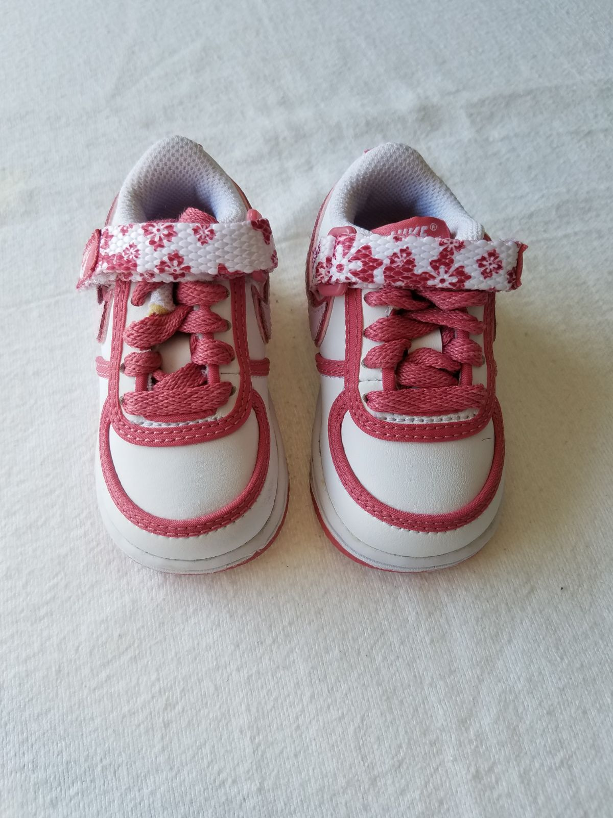Nike baby girl pink and white shoes