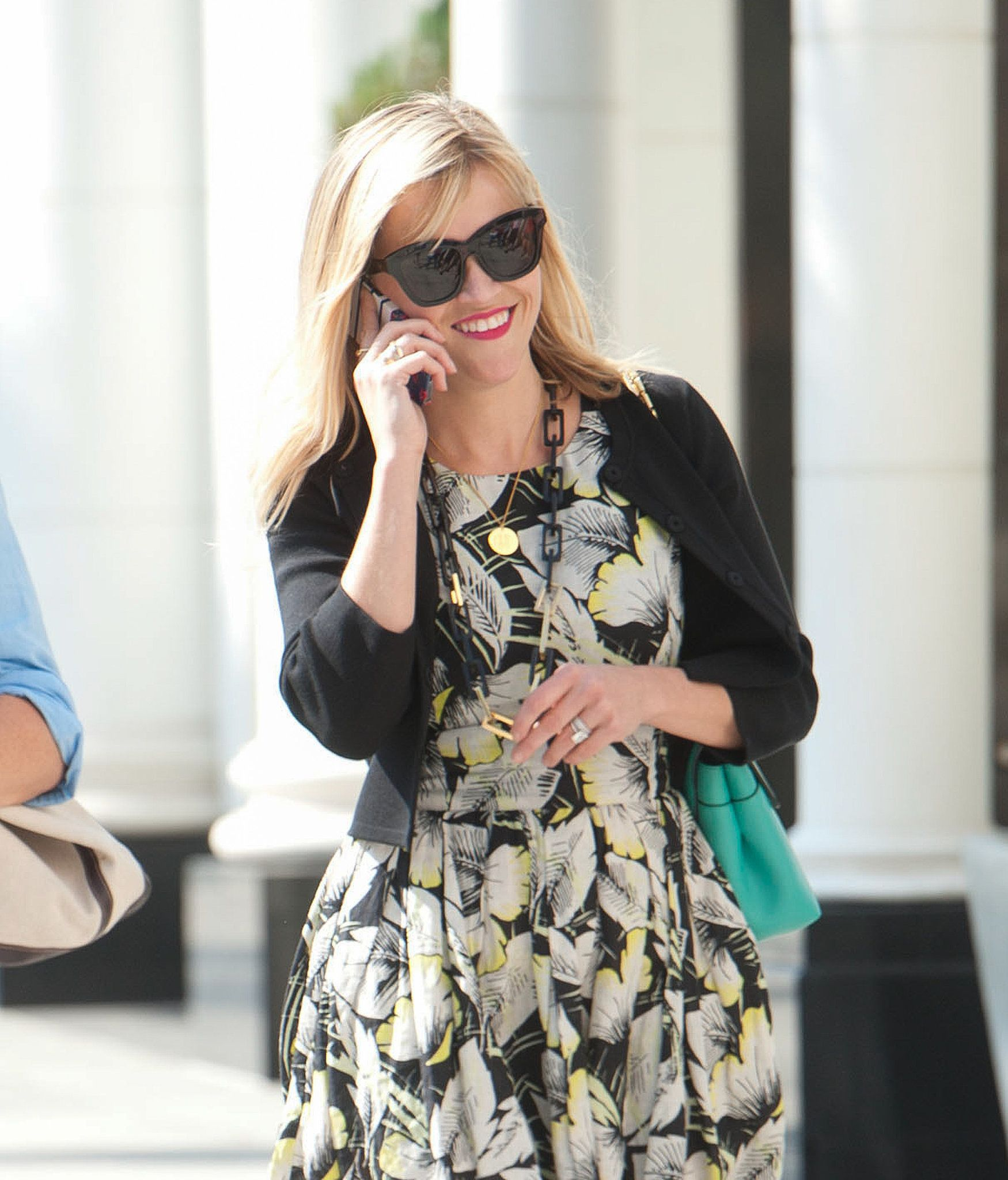 Some days, all a gal needs (Reese Witherspoon included) is a big pair of sunglasses and a bright lipstick.