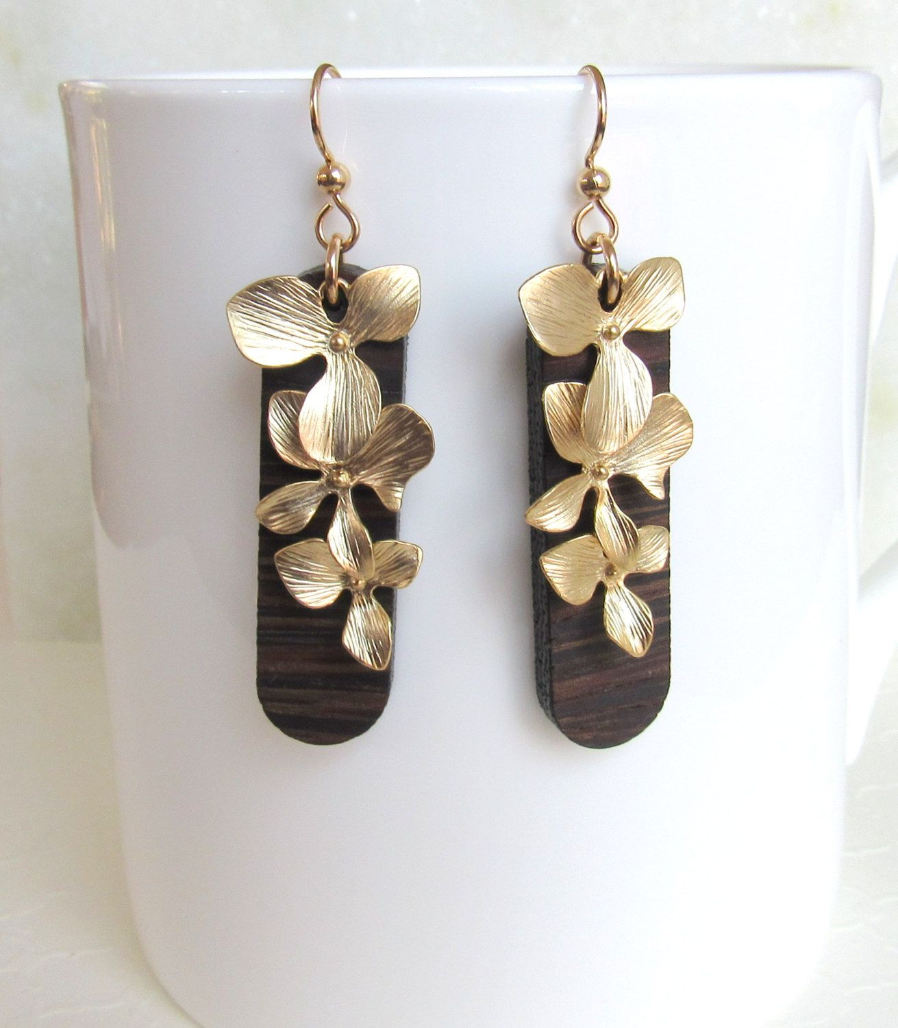 matte product jewelry long earrings gold seashell tropical