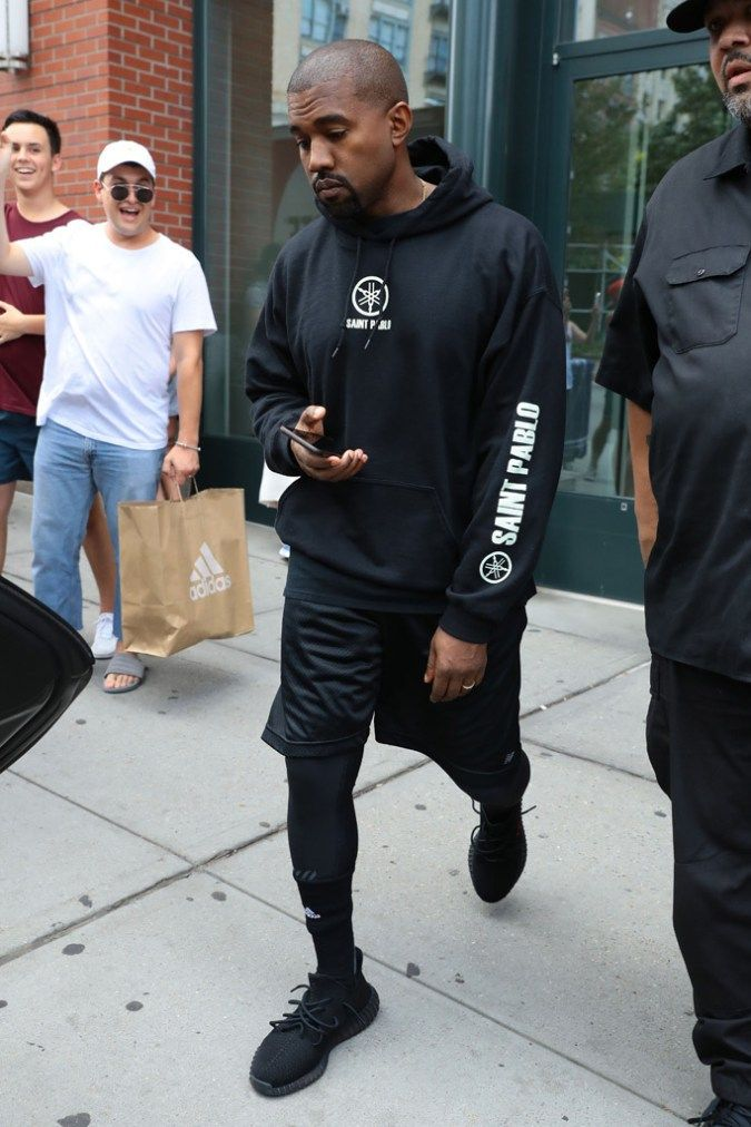 e2974dcff Kanye Wears Unreleased Yeezy Boosts and Saint Pablo Tour Hoodie