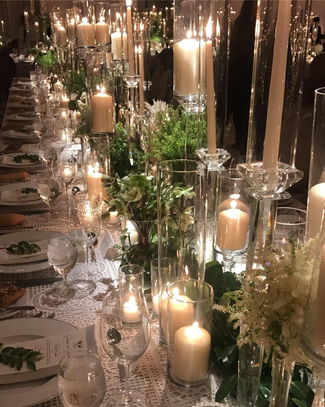 Mindy Weiss On Instagram Dinner Table Filled With Candles And Greens A Touch Of Floral Flower Centerpieces Wedding Wedding Table Settings Candle Lit Wedding