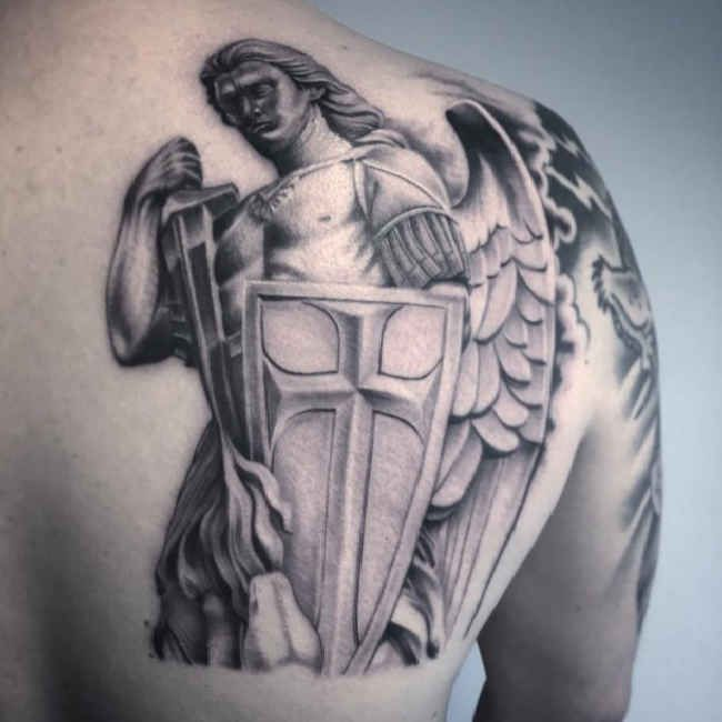angel tattoo shoulder blade of man title saint michael. Black Bedroom Furniture Sets. Home Design Ideas