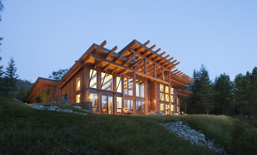 This modern timber frame home is based off precisioncraft for Contemporary log home designs