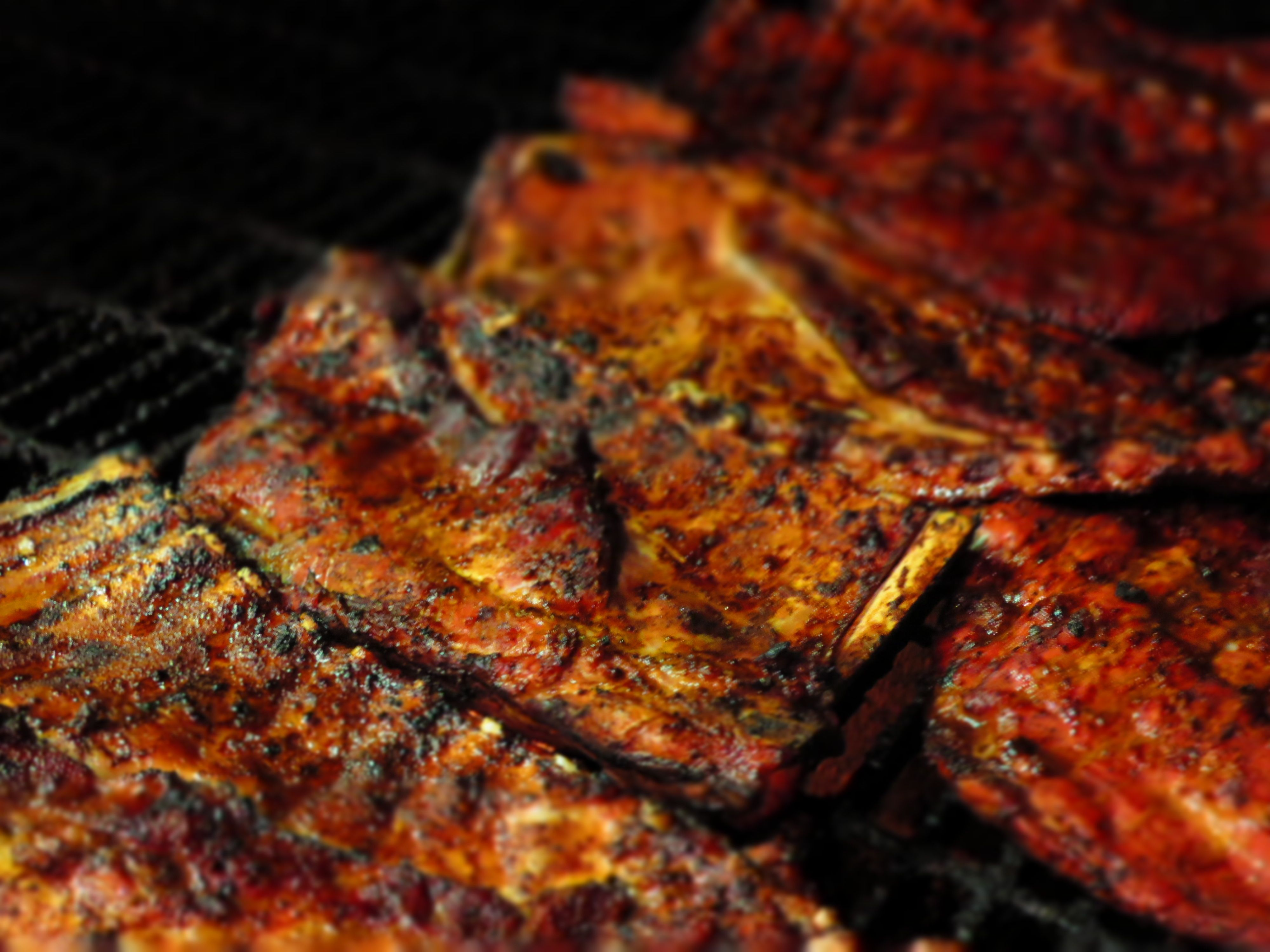 Picture of our pork ribs cooking on our 22 open hickory