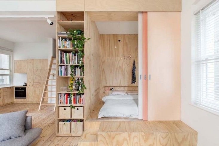Plywood master bedroom incorporates built-in storage and a headboard that serves as a dividing wall between the master bedroom and the child's bedroom on the other side of the box. Melbourne Remodelista