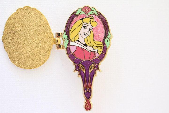 This beautiful rare Disney pin for sale features a hand held mirror that really opens up to reveal Aurora (Briar Rose) from Sleeping Beauty inside the locket with glitter and flowers. Very gorgeous, L
