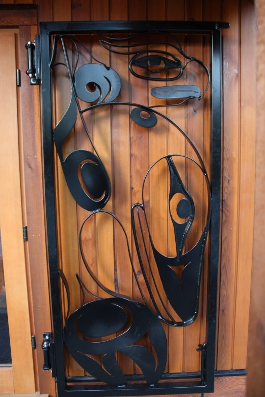 Grey Whale Steel Security door. Design by Gordon Dick. Metal smith work by Adam Plater