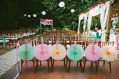 pinwheel chair backs for ceremony decor // photo by http://HeAndShePhoto.com