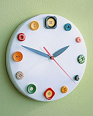 A white cookie tin lid, colorful buttons, and clock movement (available at a craft store).