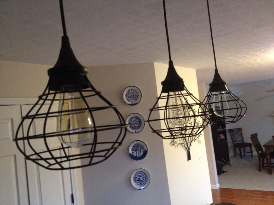 Old fashioned wire lights with Edison light bulbs above the kitchen island