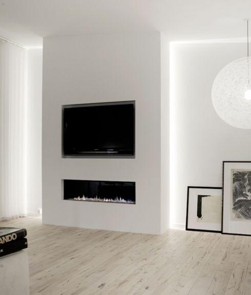 Mooi indirect licht van achter de schouw  woonkamer  Tv