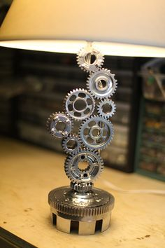 How cool is this steampunk lamp made out of bicycle gears for Steampunk furniture diy